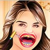 Selena Gomez has lost her beautiful smile due to her bad teeth. Only you can restore smile on her face by making her teeth crystal clear. Yes, you will have to become her dentist in order to treat her dental problems. Clean her mouth and teeth using different tools that her oral hygiene is restored. Not only that, you can even give her a lovely look with outfits and makeup items. Have fun playing this game!